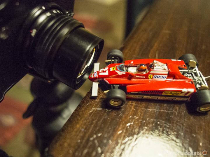 "The Gilles Villeneuve 1982 Ferrari almost ""touching"" the lens."