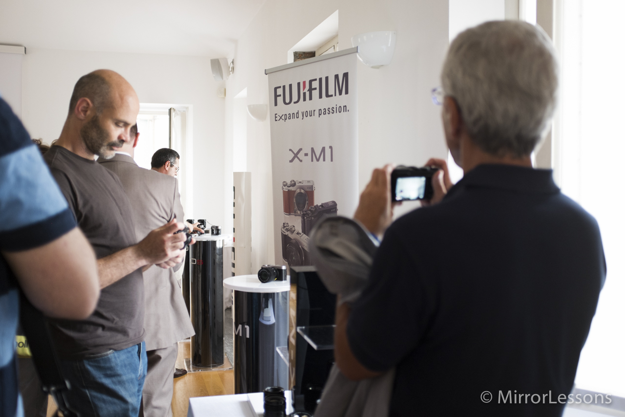 The conference room is full and everyone is testing out the X-M1.