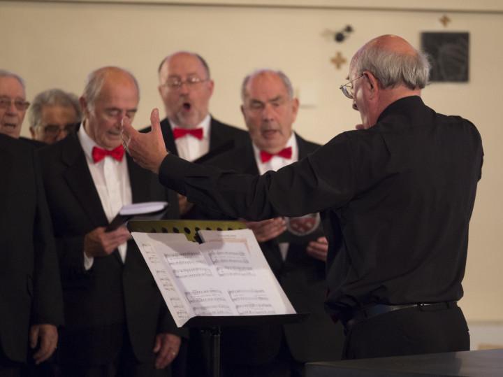 Jim conducts the choir. E-P5, 1/125, f/ 2.8, ISO 1600