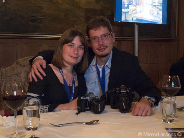 Mat and I enjoying our dinner. E-M1, 1/20, f/ 3.5, ISO 6400