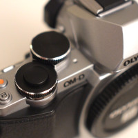 The shutter release button is bigger, which makes it nicer to use in comparison to the E-M5.