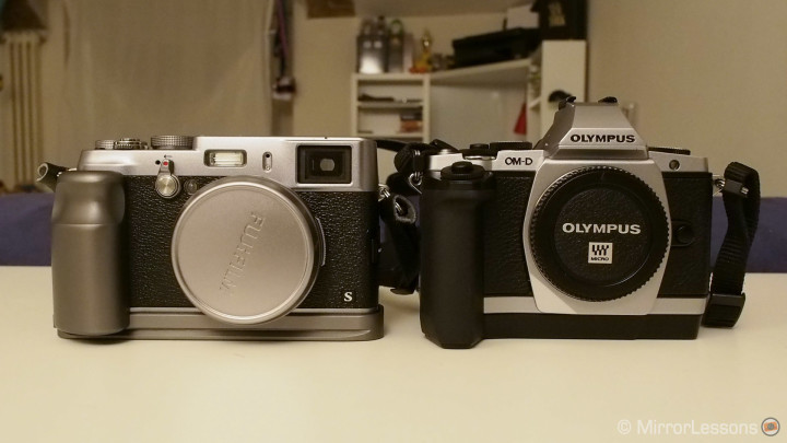X100s plus grip/tripod plate vs. the OM-D E-M5 with HLD-6 battery grip