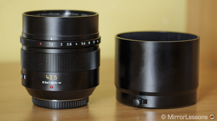 The lens and its metal hood.