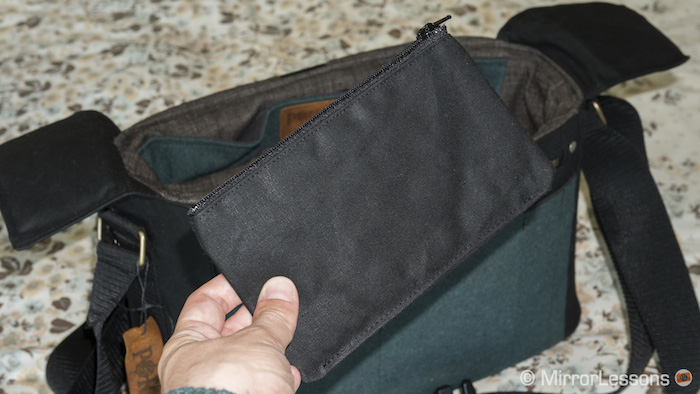 It comes with a small pouch to store business cards or memory cards.