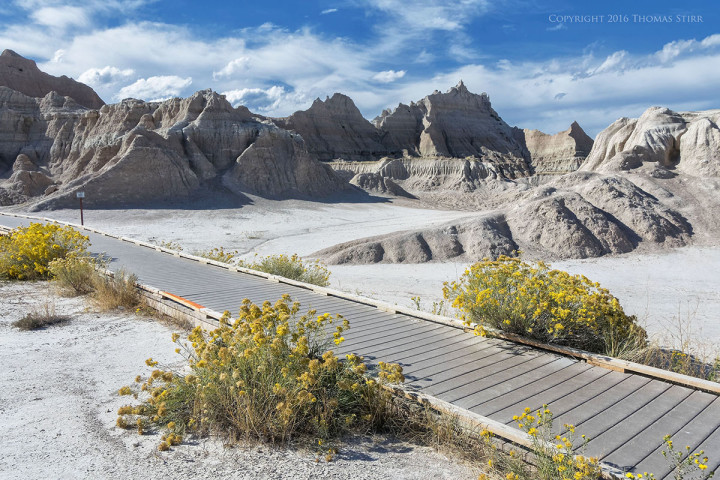 Nikon 1 J5 + 1 Nikon 10-100mm f/4-5.6, f/8, 1/500, ISO-160, 10mm, efov 27mm, Badlands National Park South Dakota.