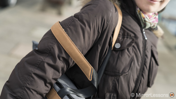 The handle can slip off your shoulder regardless of whether the leather padding is facing down or up