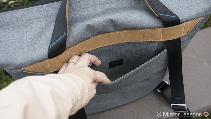 Slide the bag onto your luggage handle via the provided pass-through